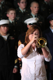 "Marisa Espinosa plays ""Taps"" during the Veterans Day ceremony."