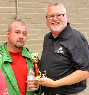 Joey Cobble, representing TG Kentucky in the Slop the Hog Contest, was the overall champion. He's pictured with Marion County Chamber of Commerce Executive Director Greg Gribbins.
