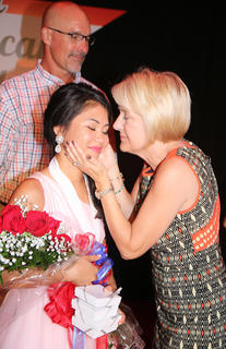 Sophie Clark and her mother, Becky, share a special moment on stage after Sophie was named the 2017 Marion County Distinguished Young Woman Saturday evening.