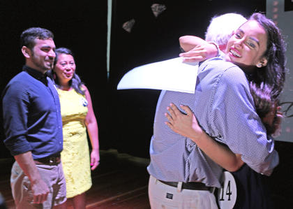 Kelly Miles gets a big hug from her dad, Bobby, as her mother, Leizel, and brother, Todd Shellhamer, observe the special moment.