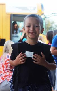 First-grader Thayden Lewis poses for a picture before entering the building.