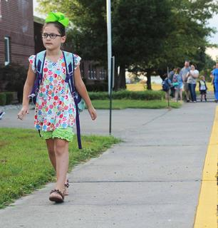 Second-grader Alex Spalding walks to the entrance of WMES on the first day of school.