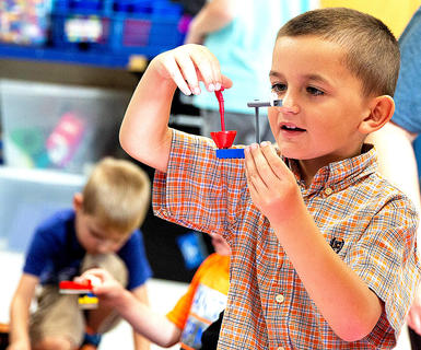 Thomas Hall does STEM activities during West Marion Elementary School's Little Pages Jumpstart.