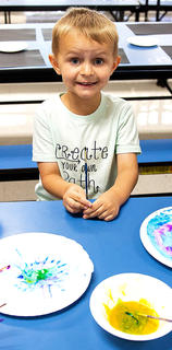 Benson Lee is excited for space-themed craft during West Marion Elementary School's Little Pages Jumpstart.