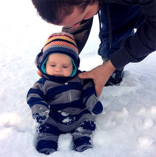 Dooley Wright took his son, Jake, out in the backyard to experience his first snow in January.