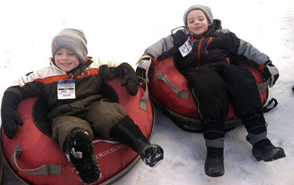 Owen and Isaac Wright get ready to snow tube down during a recent trip to Perfect North.