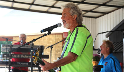 The Wulfe Brothers Band performs at the Marion County Country Ham Days Festival on Sunday afternoon. Pictured are Paul Cunningham on bass guitar, Jeff Jarboe on drums and Rod Wurtele on keyboards.