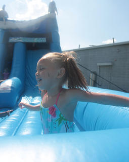 Mya Scott enjoys the inflatable water slide during First Baptist Church's Youth Explosion Aug. 20.