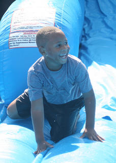 Jalil Smith, 5, is having fun on the water slide.