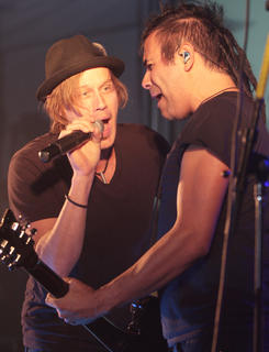 Lead singer Jason Roy and guitar player Jesse Garcia of Building 429 sing together Friday night.