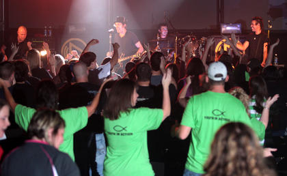 Hundreds of concert-goers got into the performance by Building 429 Friday night at Lebanon Middle School.